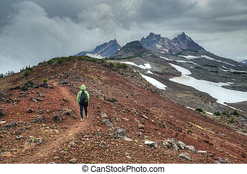 Young person hiking in Oregon Cascades - Person hiking near...