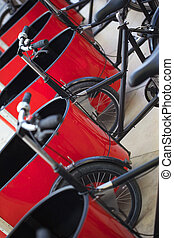 Delivery tricycles - Stylish delivery tricycles parked on a...