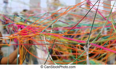 Kids Playing with Skeins Wool - Kids making a colorful net...