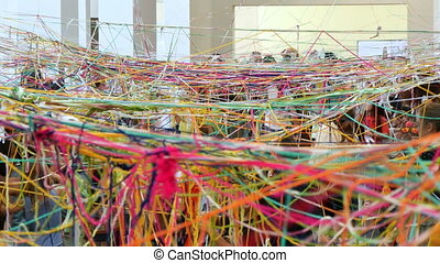 Kids Enjoying with Skeins - Kids making a colorful net of...