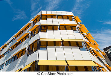 yellow sunblinds - white building with yellow sunblinds