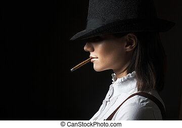 woman in hat smoking cigarette - beautiful young woman in...