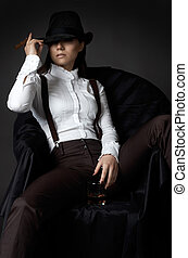 woman in hat smoking cigare - beautiful young woman on an...