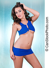 Brunette - Beautiful young brunette in a blue blouse and...