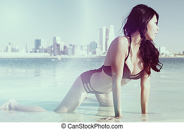Woman on gulf beach in Dubai UAE