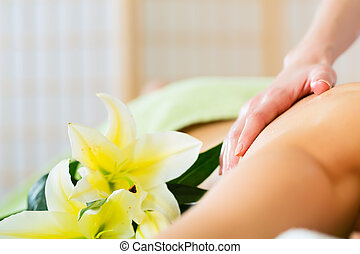 woman having wellness back massage in spa - Beautiful woman...
