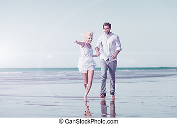 Couple on beach in honeymoon vacation