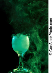 Green smoke in the glass. Halloween. - Abstract art. Hookah...