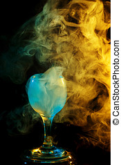 Yellow-green smoke in a glass. Halloween. - Abstract art....