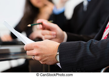 Business people during meeting in office - Business people...