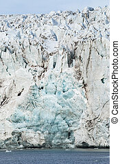 Close up of blue ice in the glacier by the sea, Svalbard -...
