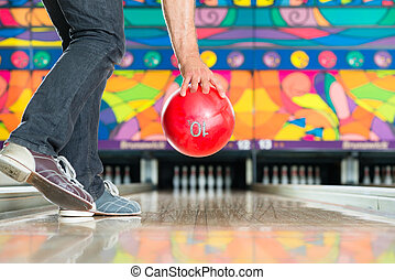 Young man bowling having fun - Young man in bowling alley...