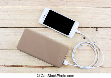 Smartphone with golden powerbank. - Smartphone with golden...