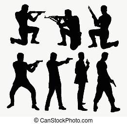 Man with gun silhouettes