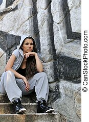 Young woman in hip hop style portrait - Young person...