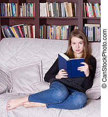 Woman at the library reading book - Woman at the library...