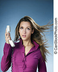 phone call - business woman being yelled over the phone....