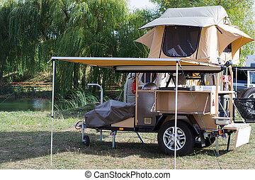 Car tourist tent with all the amenities installed on a...
