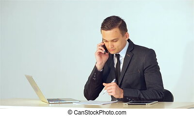 Young businessman talking on the phone - Young businessman...