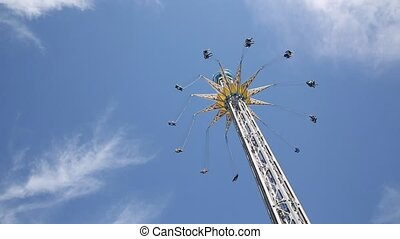 Flying swing in amusement park
