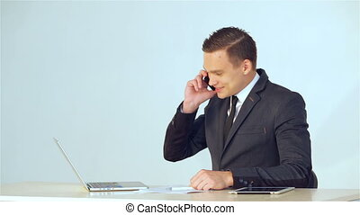 Young businessman making a phone call - Smiling young...