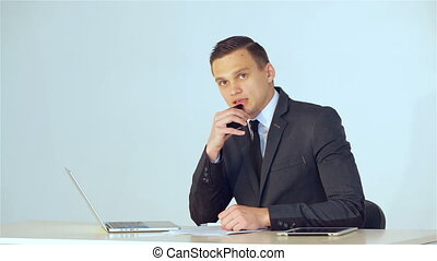 Young businessman listens attentively