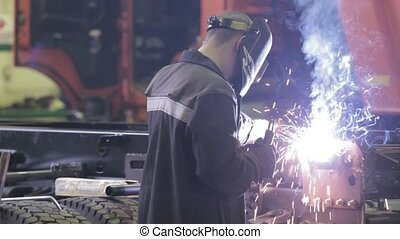 worker with protective mask welding metal HD