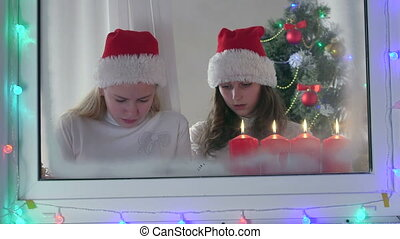 Children with gifted new electronic gadget near Christmas tree