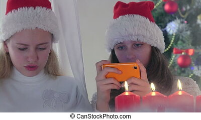 Children at home using new smart phone gifted for Christmas