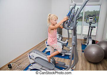 girl training in the gym - little blond girl training in...