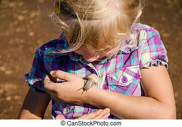 girl with snail - little girl watching snails on her hand