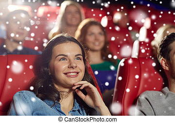 happy woman watching movie in theater