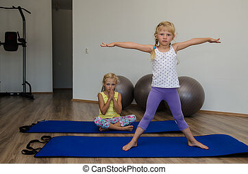 girls in the gym - two little blond girls in gym with gray...