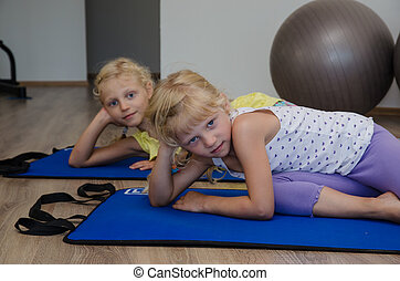 beautiful girl in the gym - two little blond girls in gym...