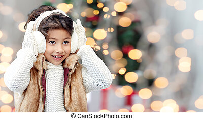 happy little girl wearing earmuffs at christmas - winter,...