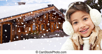 happy little girl wearing earmuffs - winter holidays,...