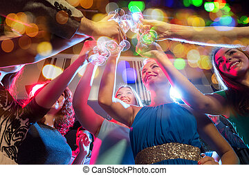 happy friends with glasses of champagne in club - party,...
