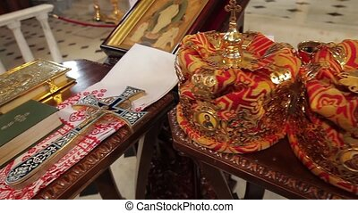 Church attributes for the wedding ceremony Gold crowns are...
