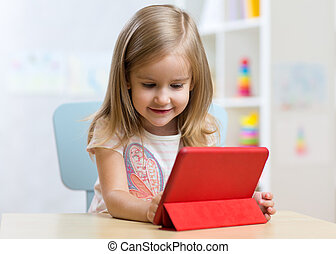Child girl with tablet on floor at home - Child girl with...