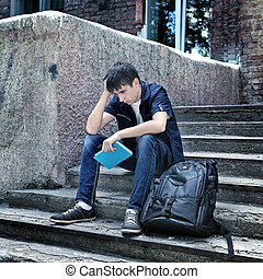 Sad Student outdoor - Toned Photo of Sad Student with the...