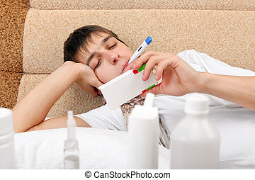 Sick Young Man with Thermometer - Sick Young Man with pack...