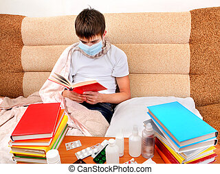 Sick Teenager read the Book - Sick Young Man in Flu Mask...