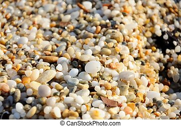 colored sea pebbles - close up photo of colored sea pebbles