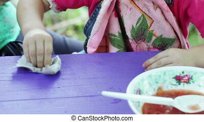 Little girl wiped napkin - Girl on nature of table and wipe...