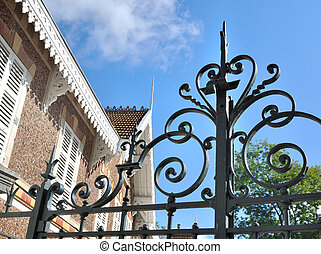 wrought iron gate - closeup on a wrought iron gate in front...