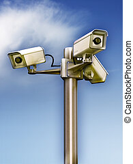 Surveillance cameras - Three surveillance cams on a metal...