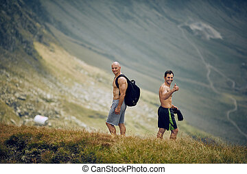 Male hikers on mountain trail