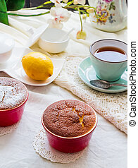 lemon pudding red saucers, tea, english dessert,on a white...