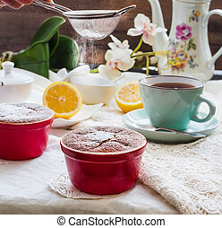 sprinkle with powdered sugar lemon pudding red saucers, tea...