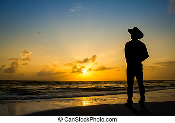 Man in the morning at the beach. - Men wore hats stood watch...